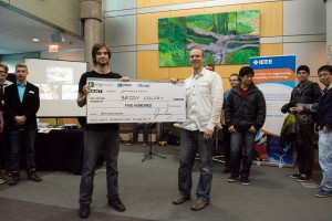 Jason Long presents Brody Holden with the MPG bursary at the UVic wrap-up party on March 26, 2015.