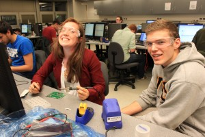 Students having fun soldering at the first MPG at UVic in 2013.